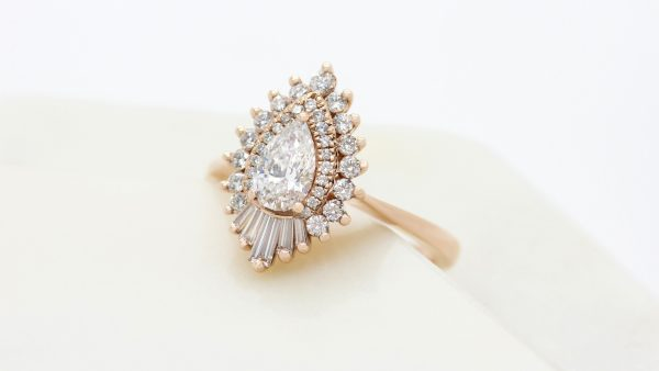 16878 - unique engagement ring with pear centre diamond double diamond halo and fanned tapered baguettes