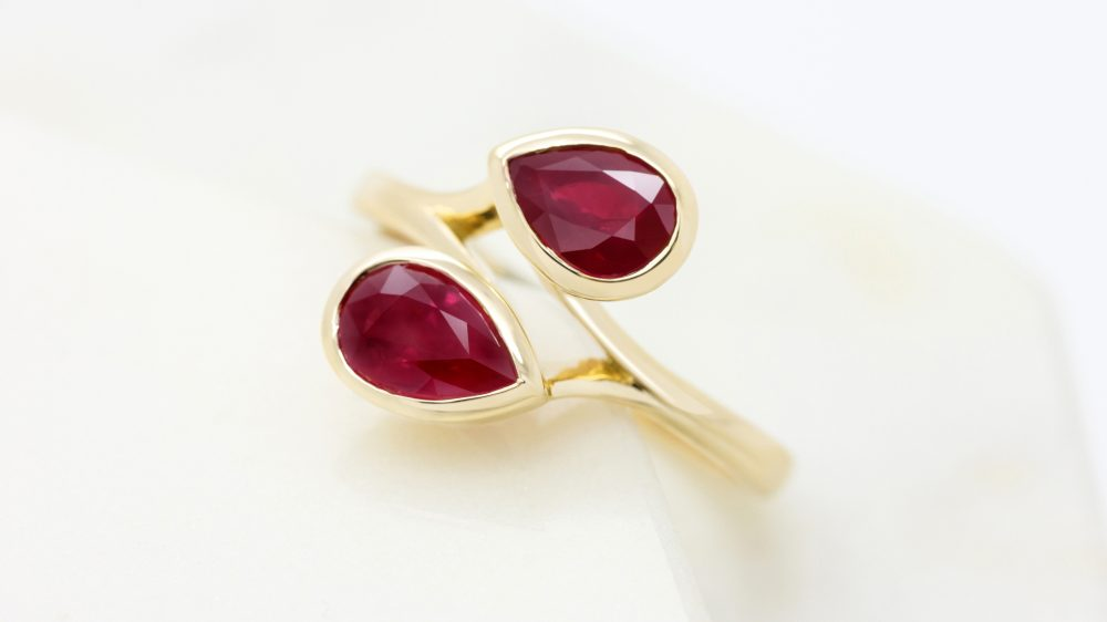 14576 - pear shape ruby moi et toi yellow gold engagement ring