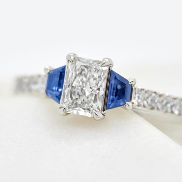 blue sapphire trapezoid side stones
