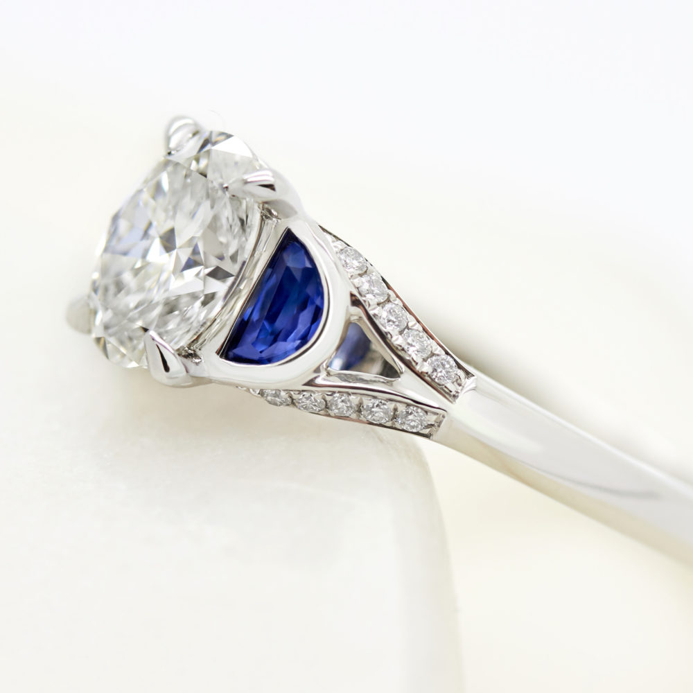 blue sapphire half moon side stones