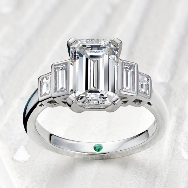 emerald cut diamond engagement ring with diamong baguette side stones