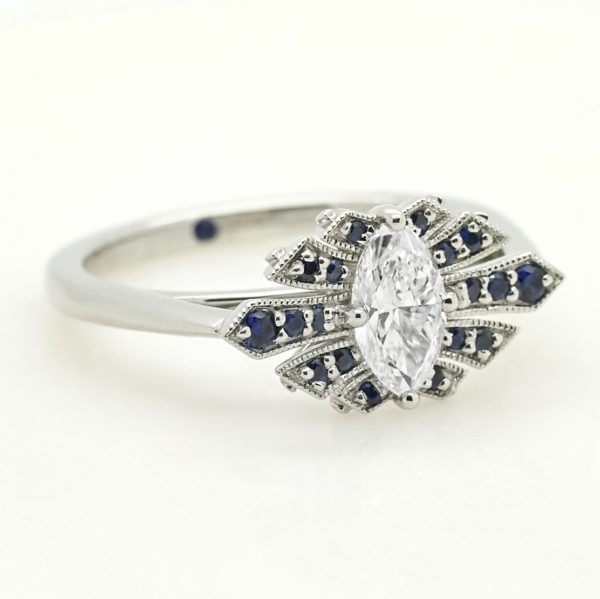 marquise diamond custom engagement ring with fanned pave blue sapphires