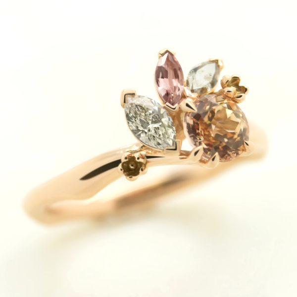 custom organic engagement ring with marquise shape diamond and sapphires