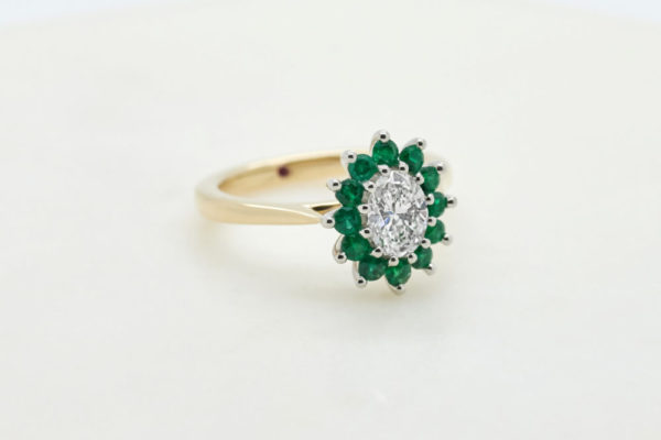 Yellow gold oval diamond emerald halo engagement ring