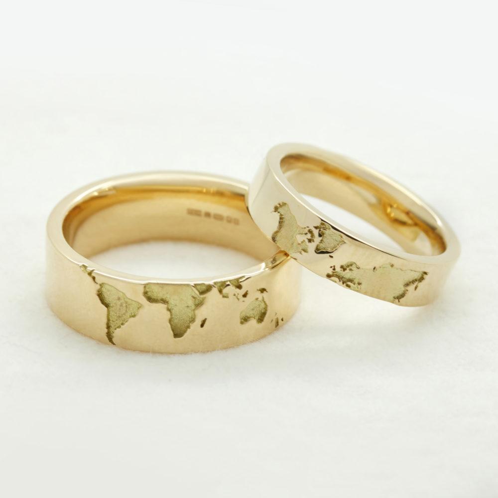 world map engraved matching wedding rings yellow gold