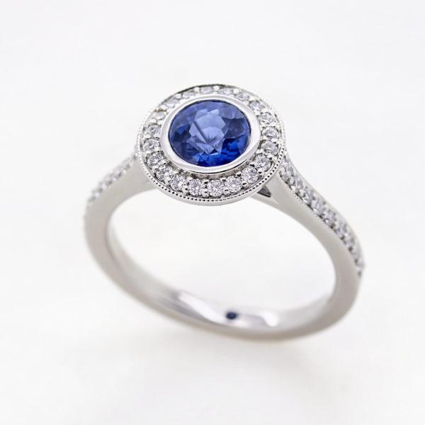round blue sapphire diamond pave halo platinum engagement ring