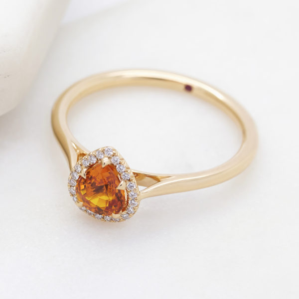 Taylor and Hart pear shaped orange sapphire yellow gold band solitare