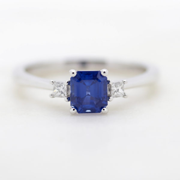 Blue sapphire princess cut white gold side diamonds engagement ring