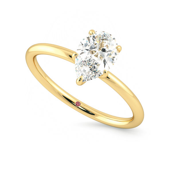 Yellow gold solitaire engagement ring with a pear shaped diamond