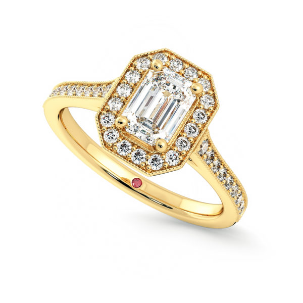 The yellow gold talisman engagement ring, with an emerald cut diamond and halo and channel set pave with milgrain.