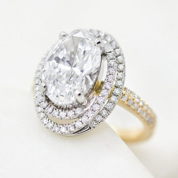 oval diamond twisted diamond halo engagement ring yellow gold platinum mixed metal