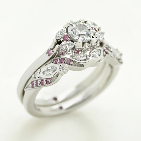 custom fitted matching engagement and wedding ring with diamond and pink sapphires