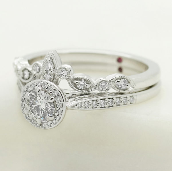 round diamond halo engagement ring with organic marquise and round shape matching wedding ring