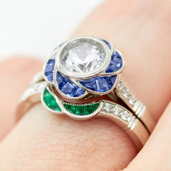 custom cut blue sapphire and emerald engagement and wedding ring set