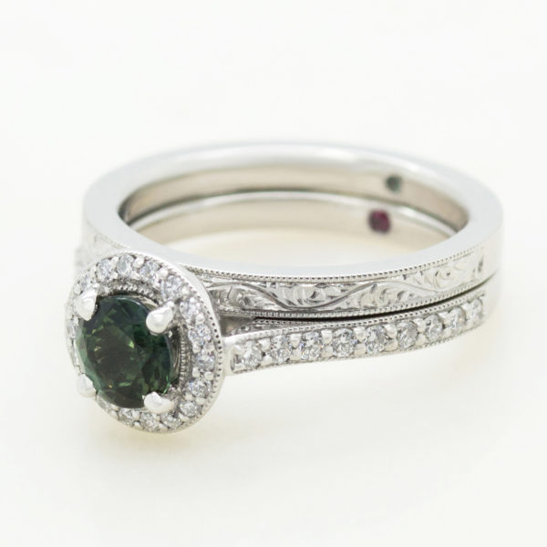 green sapphire halo engagement ring with matching fitted engraved wedding ring