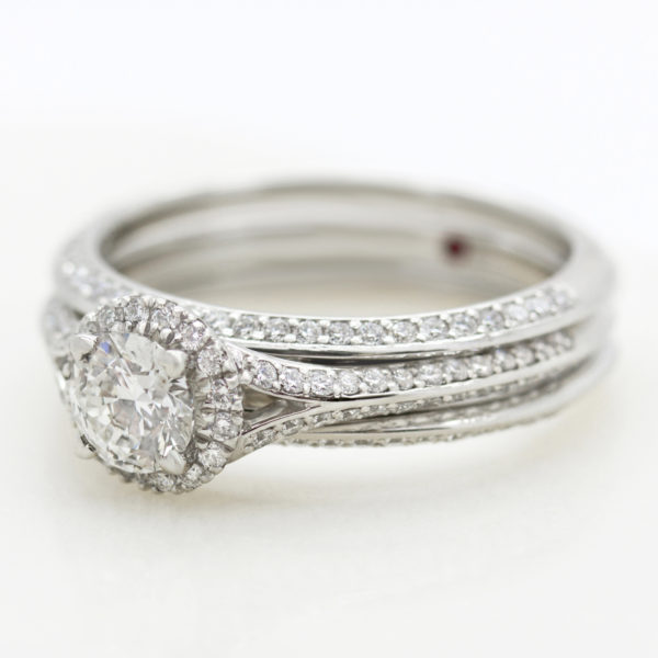 round diamond halo engagement ring with matching diamond pave wedding ring sleeve jacket