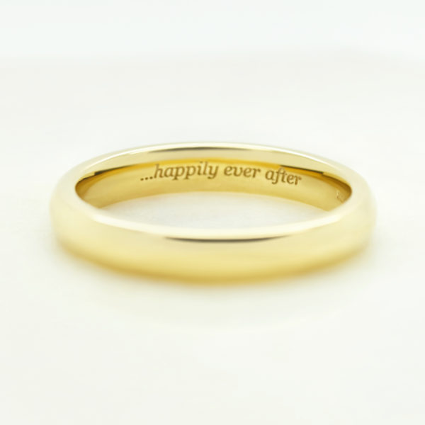 yellow gold custom wedding ring with engraving inscription
